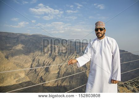 Jebel Shams, Oman, October 2016: Omani man in Jebel Shams mountains