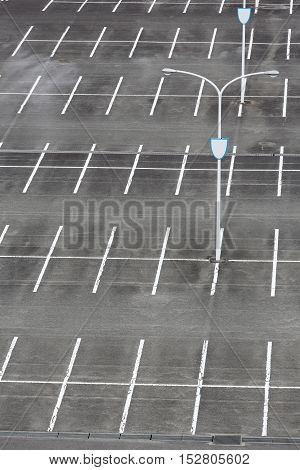 vacant car parking lot with white mark and light pole