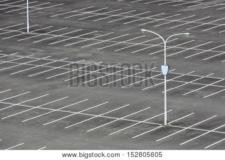 vacant car parking lot with white mark and light pole poster