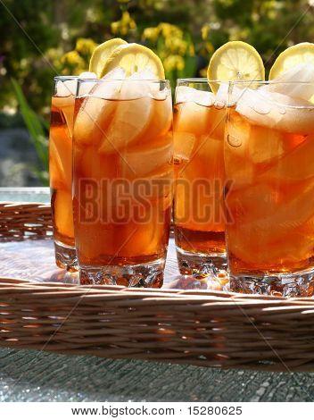 Glasses of refreshing lemon ice tea, outside in the summertime.