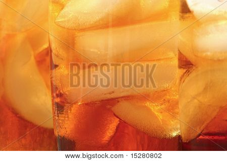 Ice tea  and ice cubes background