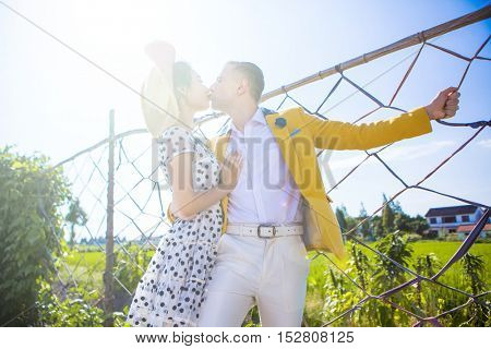 Multi ethnic inter racial couple kissing