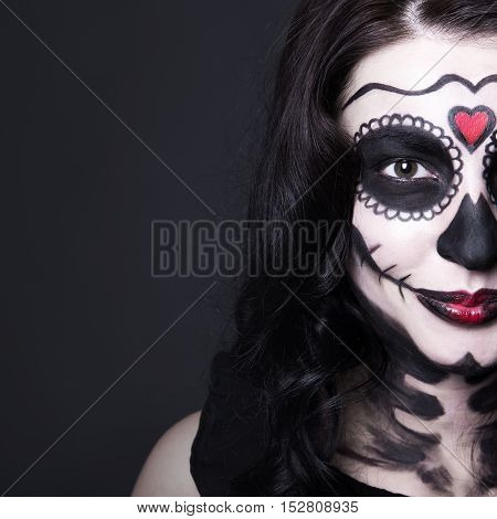 Close Up Portrait Of Woman With Halloween Skull Make Up Over Grey