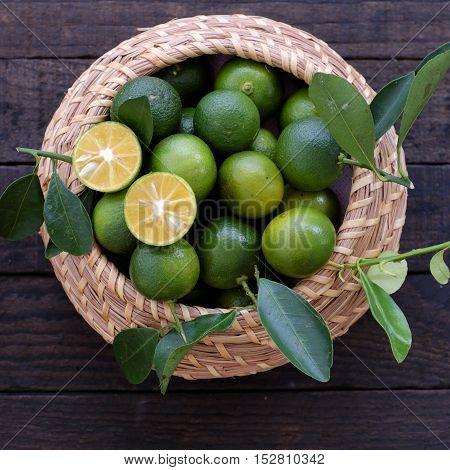 Green Kumquat Fruit On Wooden Background