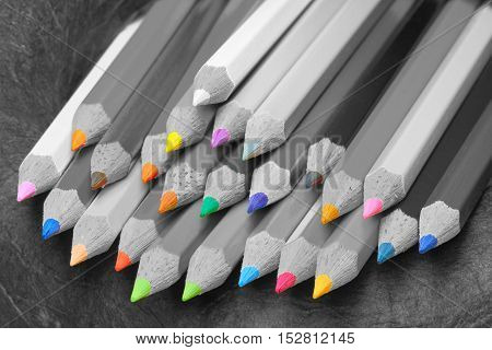 Crayons in several colors are arranged side by side.