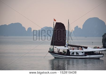 Tourist junk floating in Halong bay, Vietnam