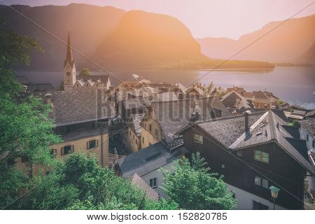 Sunny summer day in the Hallstatt village in the Austrian Alps. Maria am Berg church and Hallstattersee lake, Austria, Europe, toned like Instagram filter