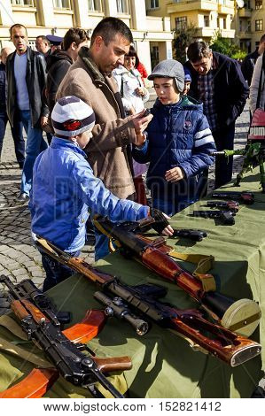 Uzhgorod Ukraine - 14 October 2016: Local residents consider the exhibition of small arms during the celebration of Defender of the Fatherland Day. This day Ukraine celebrates the Day of Defender of the Fatherland.