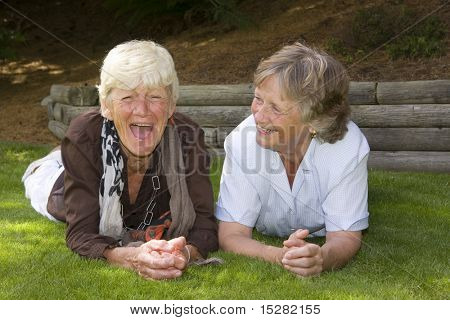 Two ladies laughing together. Best friends for fifty five years.