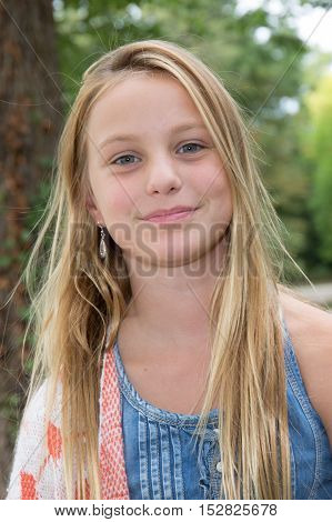 a Portrait of 10 -year-old blond girl