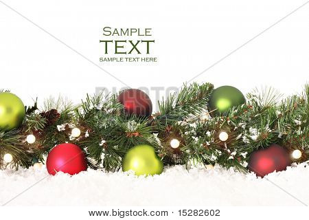 Christmas border of evergreen, ornaments, lights and snow. poster