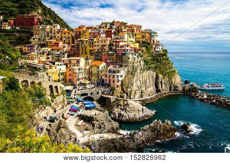 Traditional picturesque Manarola village, Cinque Terre, Italy, Europe. The Cinque Terre is a rugged portion of coast on the Italian Riviera.