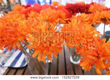 Bright and Beautiful Orange Artificial Daisy Gerbera Flowers in Glass Vase for Home and Office Decoration without The Care.