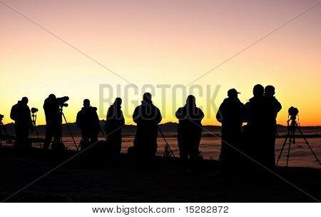 Photographers at sunrise.