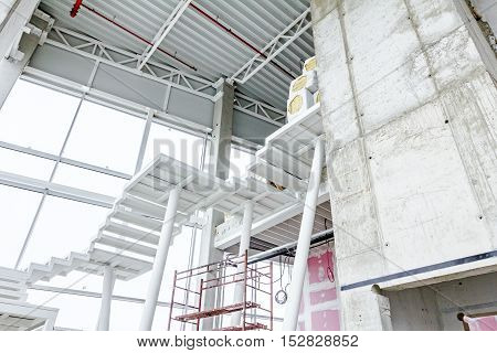 Metal pillars are support to crisscross stairs leading up. Architecture concept poster