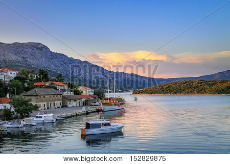 Croatian Island Korčula on beautiful summer sunset. Popular Europe tourist destination. Small harbor for summer sailing yachts
