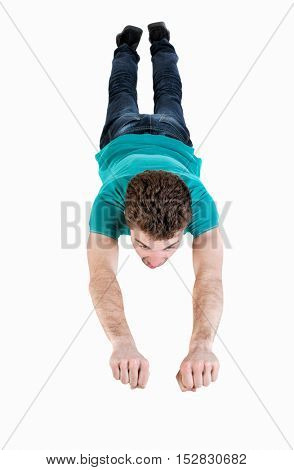 Flying man . Smiling curly-haired guy is flying in Superman pose.   Isolated over white background. Top view of the flying man.