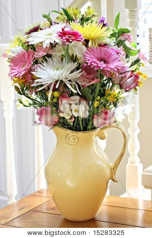 Vibrant spring flower bouquet in home interior.