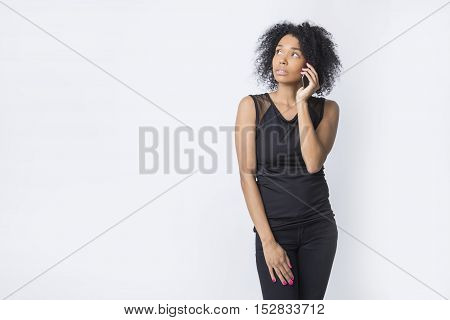 Serious African American Woman Is Talking On Her Phone