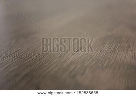 Dark brown laminate floor texture in the room