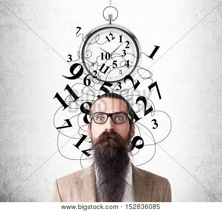 Baffled man with beard and glasses standing near concrete wall with broken stopwatch on it. Concept of time management gone wrong