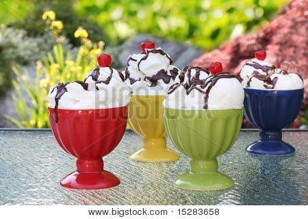 Ice cream sundaes. Focus on the front two bowls.
