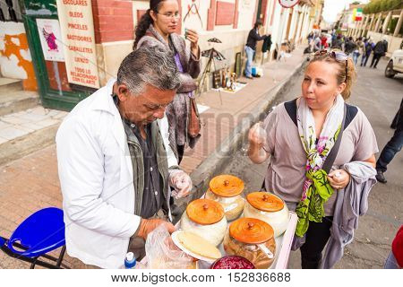COLOMBIA, BOGOTA - CIRCA MAY 2013: Tradicional colombian sweet prepared by a man on the Candelaria.