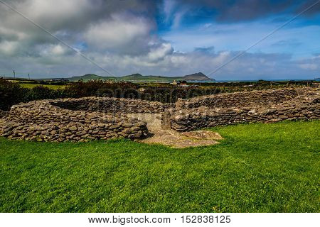 A ruined early Monastic site in County Kerry, Ireland. This site gives a very good idea of the layout of a small monastery of the Early Medieval period.
