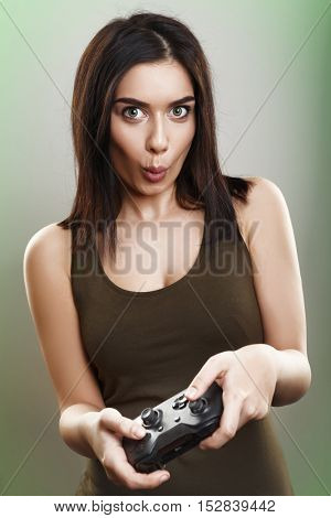 Young girl playing video games with controller