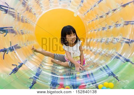 Happy Asian Chinese Little Girl Playing Roller Wheel