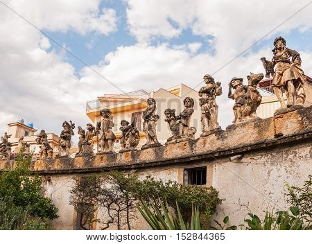 This is famous grotesque statues with human faces that decorate garden and wall of the Villa Palagonia or The Villa of Monstersnear Palermo Sicily Italy.