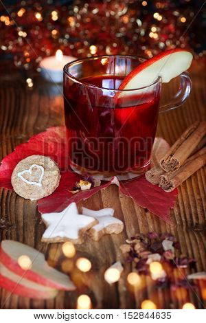 Mulled wine with Christmas cookies and spices on a Christmas market