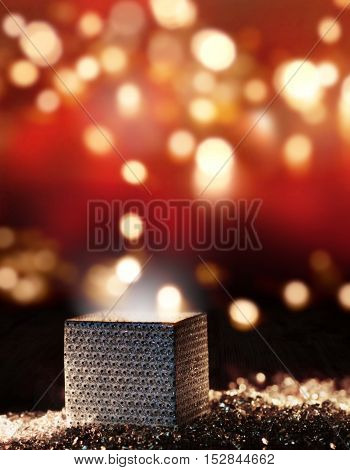 Imaginative present for lovely dreams in front of a red background with golden lights