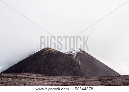 The smoking crater of Mount Etna in Sicily Italy.