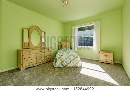 Green Kid's Bedroom With Wooden Carved Furniture And Gray Carpet