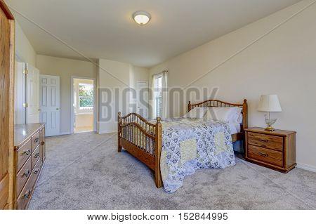 Spacious Light Tones Bedroom With Queen Size Wooden Bed