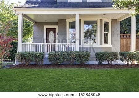 American House With Well Kept Front Yard.