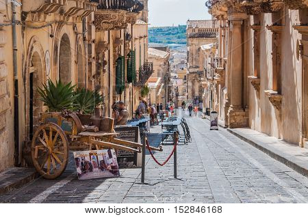 NOTO ITALY - SEPTEMBER 14 2015: Traditional Sicilian cart on street in old city centre of Noto Sicily Italy. UNESCO World Heritage Site.