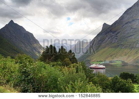 Ship at dramatic landscape, Hjorundfjord, Fjordland, Norway