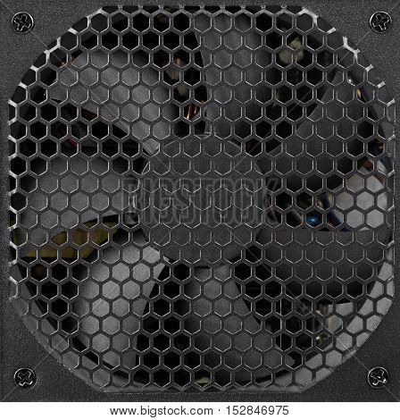 Black power supply unit cooling and ventilation system close-up