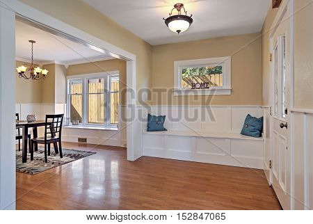 Entrance Hall With Wood Paneled Walls And Comfortable Seat