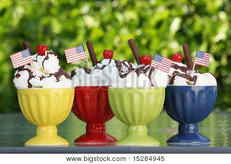 Ice cream sundaes with American flags for July 4th.