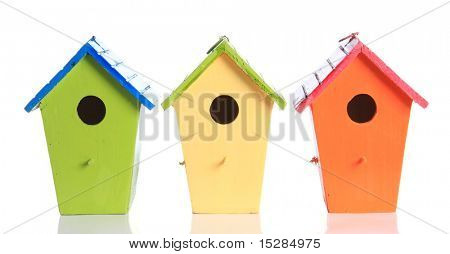 Colorful bird houses isolated on white.