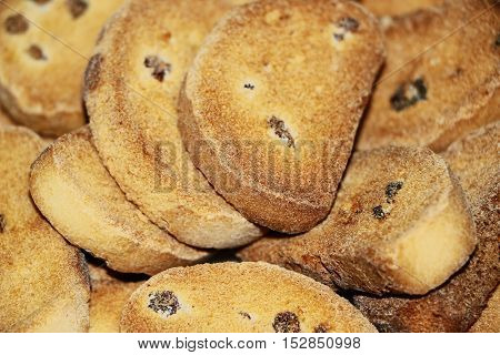A small amount of crackers with raisins close-up.