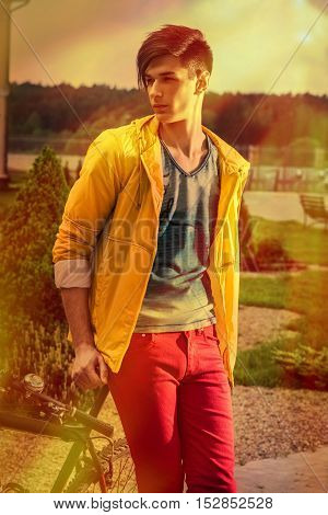 Confident wealthy young man in the garden