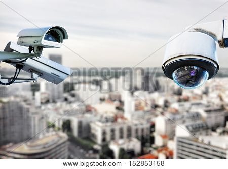security CCTV camera or surveillance system with Paris on blurry background poster