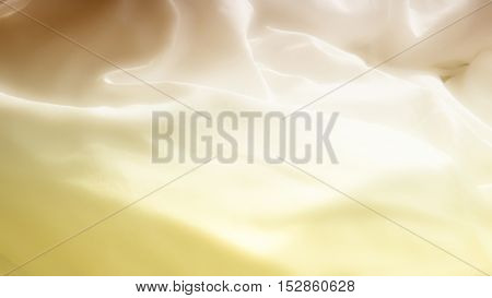 closeup of soft white bedsheets in yellow light
