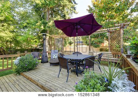 Backyard Patio Area With Outdoor Wicker Furniture