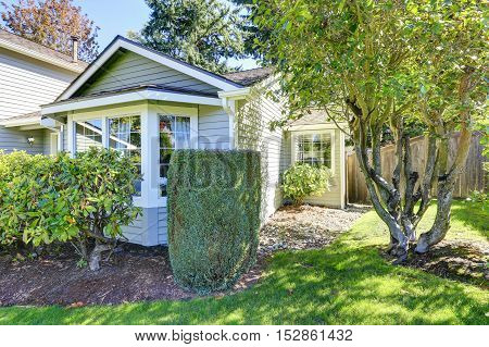 Gray Siding House On A Sunny Day
