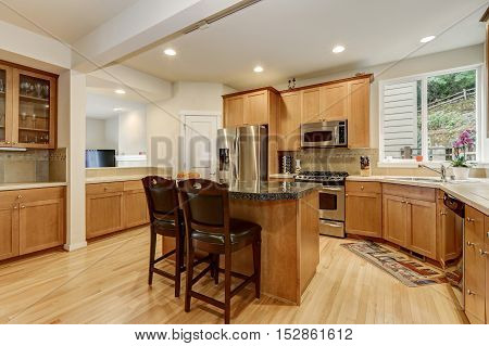 Bright Wooden Kitchen Room With Stainless Steel Appliances